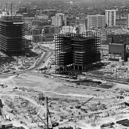 c. From the aerial photo of the area of government center one can clearly see that the replacement fabric had neither coherence nor relevance to the Boston context. Government Center under construction in 1964. Boston Globe via Getty Images